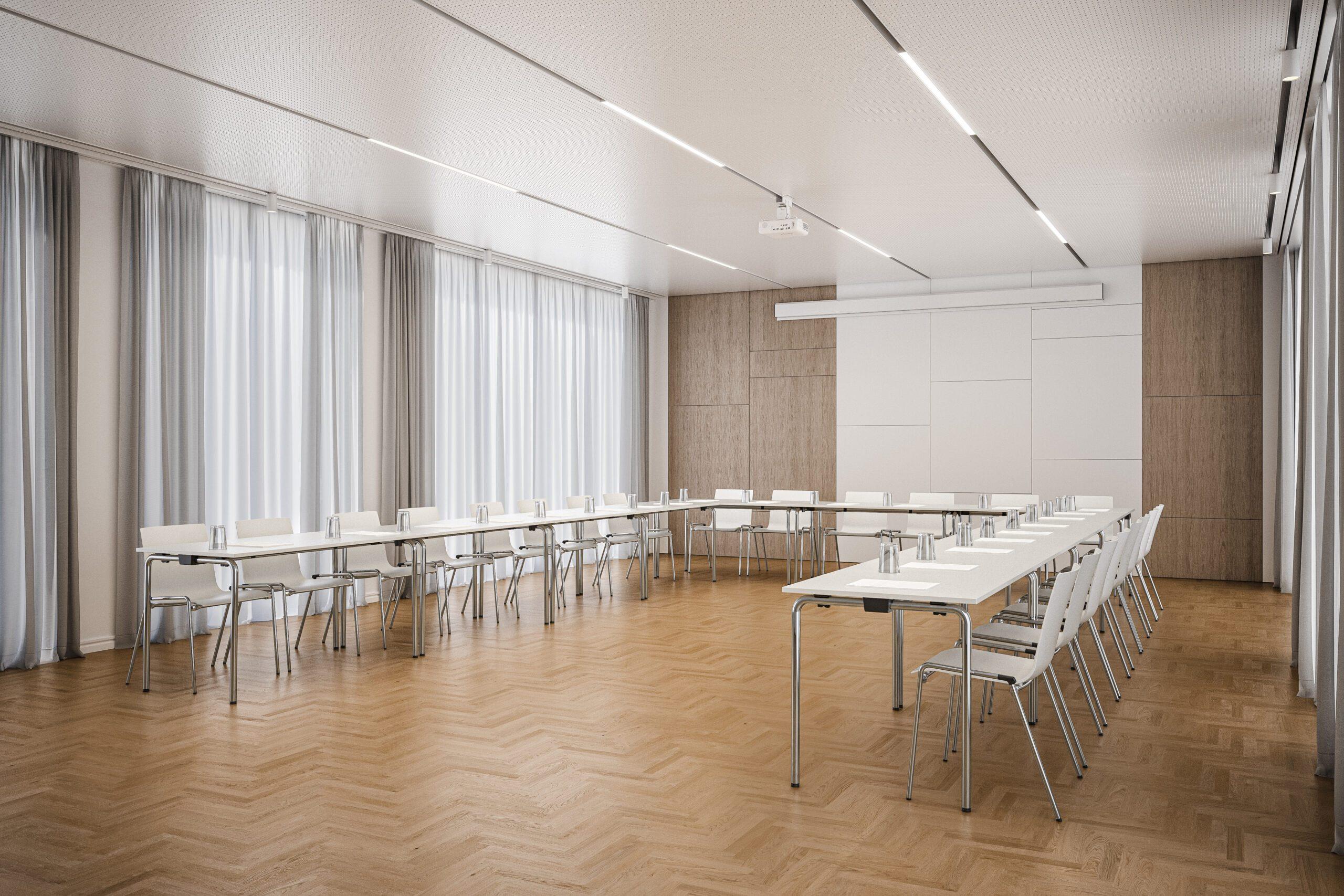 Seminarraum mit Leinwand im Hintergrund. Die Tische 1196 sind in der Form des Buchstaben U aufgestellt und ermöglichen eine Kommunikationssituation.
